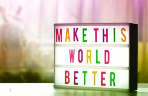 Make this world better sign